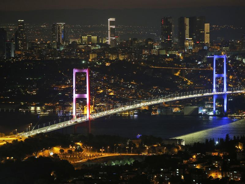 Istanbul's iconic Bosporus Bridge is lit in the colours of the French flag in solidarity with the victims of Thursday's attack in Nice, France, in Istanbul. (AP Photo)