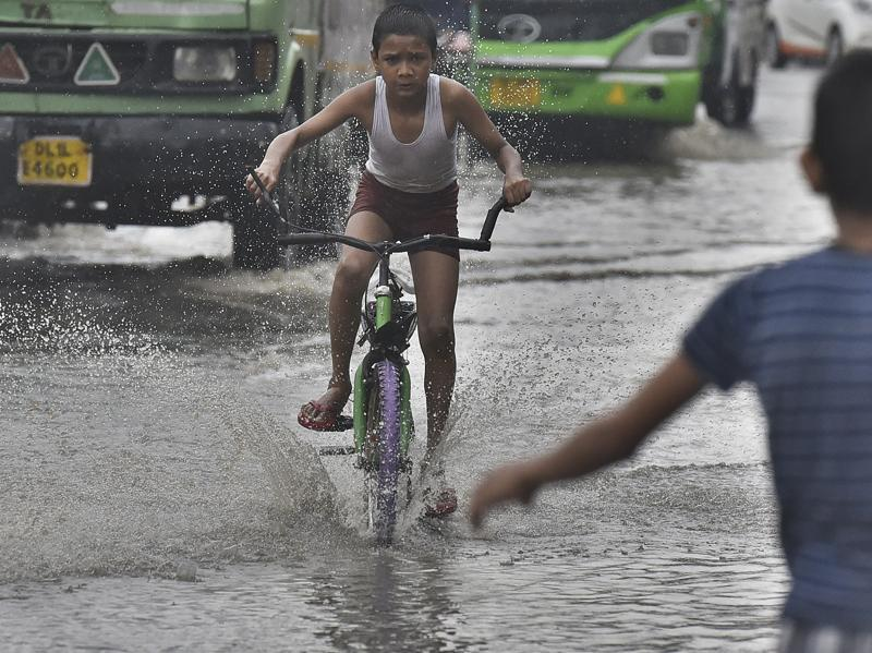 Heavy rains in the national capital have caused major water logging in several areas, leaving residents and commuters stranded and causing traffic snarls.  (Raj K Raj/HT Photo)