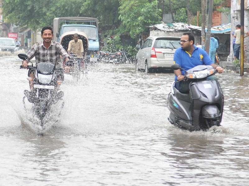 Miles to go: While some enjoy the weather and water (left), some are clearly not happy(right)!  (Pardeep Pandit/HT Photo)