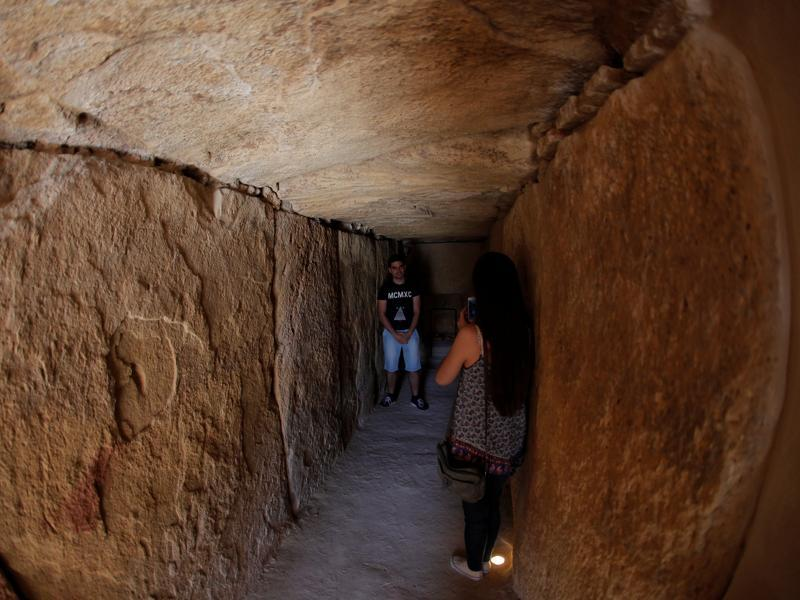 A woman takes a photo inside the Viera dolmen. (REUTERS)