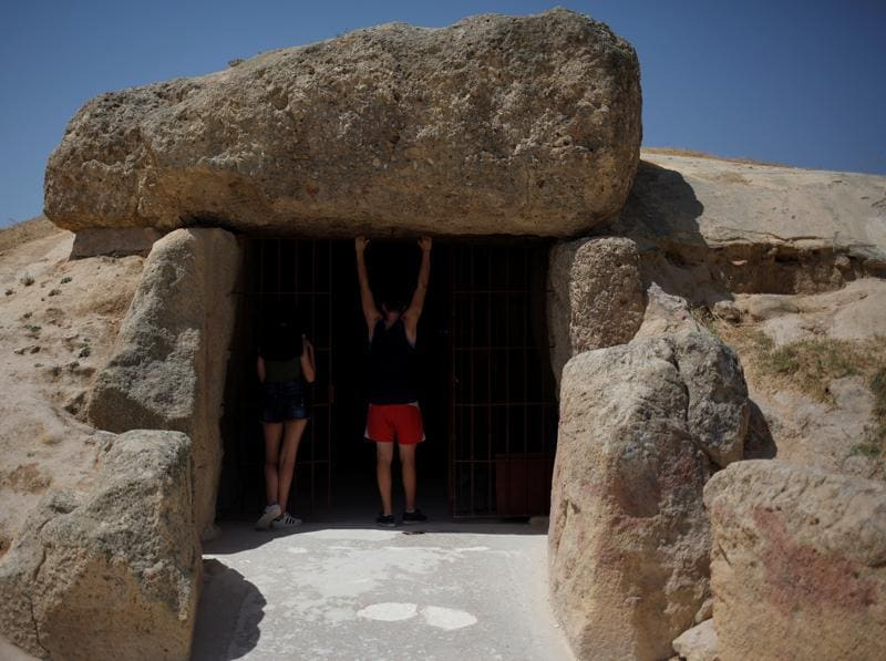 People enter the Menga dolmen. (REUTERS)