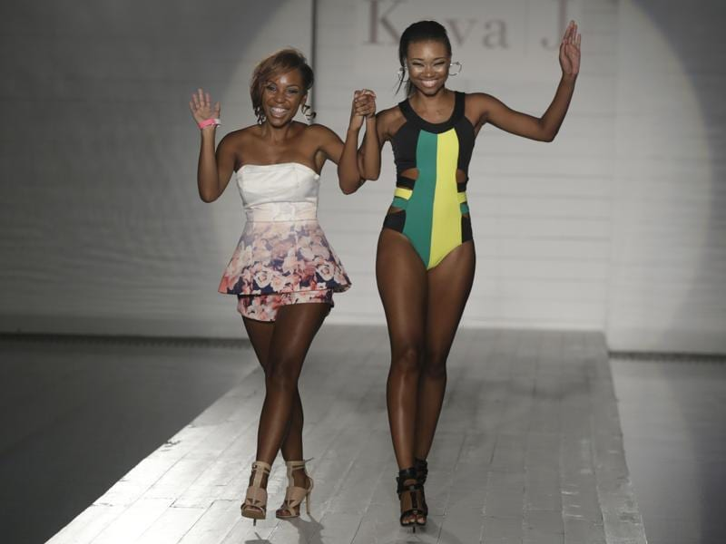 Designer Keva Johnson, left, walks down the runway with a model. (AP)