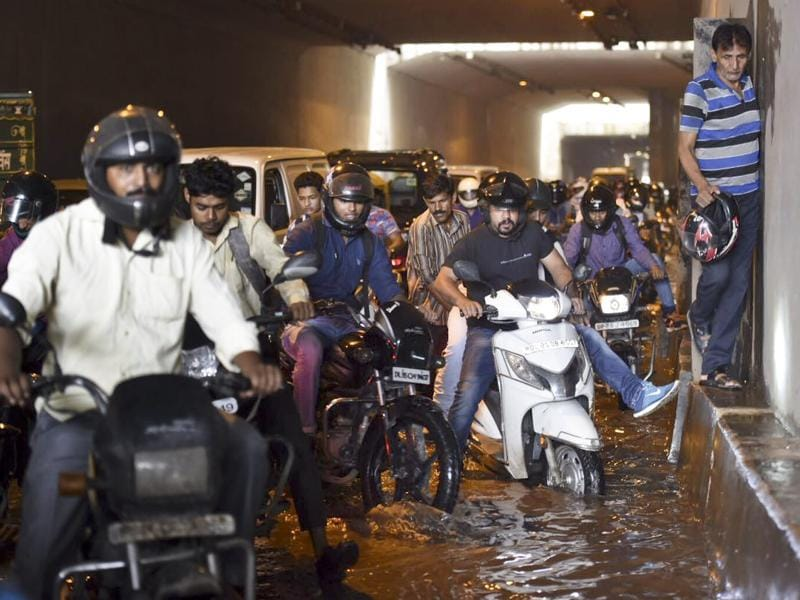 Commuters navigate through a water logged underpass at Sarita Vihar after rains in New Delhi on Monday, July 18, 2016. (Saumya Khandelwal/HT Photo)