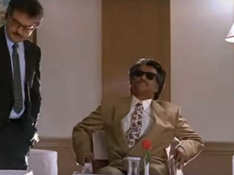 In Annamalai (1992), don't miss his former Western suit look.