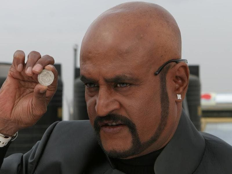 As a star, he never hides his bald head in real life. But with Sivaji (2007), he experimented with a bald look coupled with a stylish beard. Hmm!