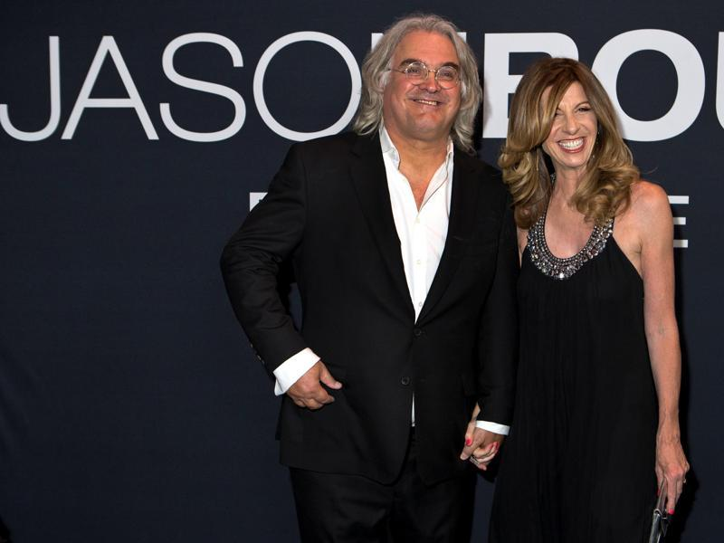 Director Paul Greengrass and wife Joanna pose for the cameras at the premiere of Universal Pictures' Jason Bourne. (REUTERS)