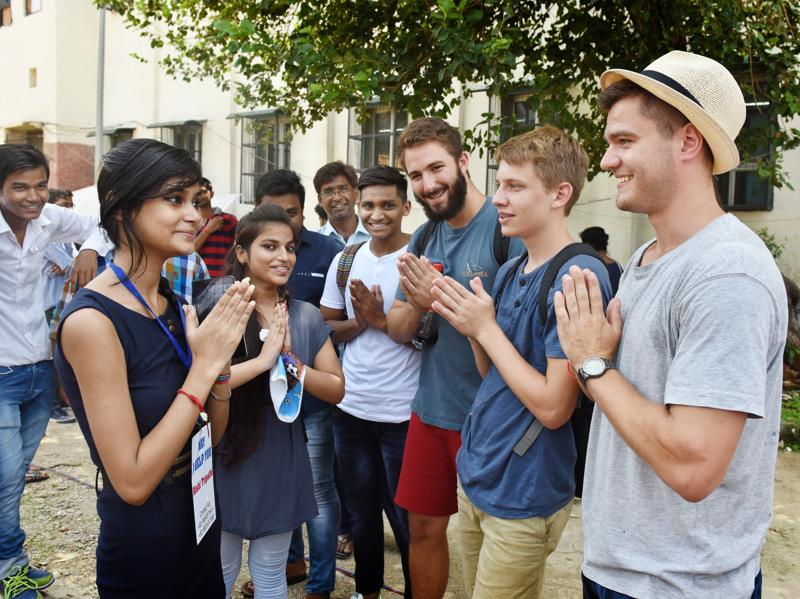 Foreign students having fun with Indian students during cultural exchange program on the first day of the college at Ramjas College. (Sushil Kumar/HT Photo)