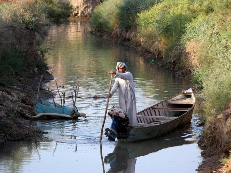 An Iraqi man rides a boat in the Ahwar area in the southern Maysan province -- also known as the Iraqi Marshlands -- one of the world's largest inland delta systems.  (AFP)