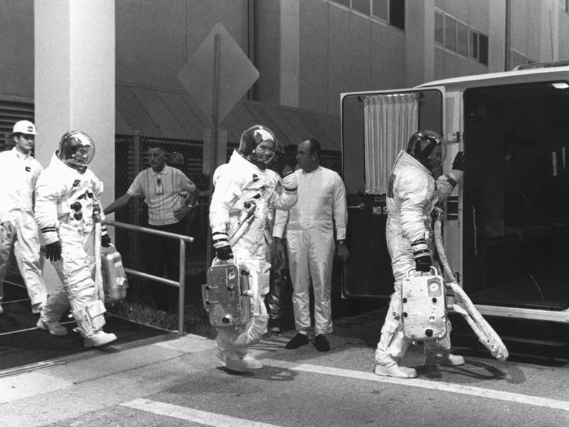 "Three astronauts were selected for the audacious mission -- command module pilot Michael Collins, mission commander Neil A Armstrong, and lunar module pilot Edwin ""Buzz"" E Aldrin, Jr. This image shows them suited up for a countdown demonstration test on July 16, 1969.  (NASA)"