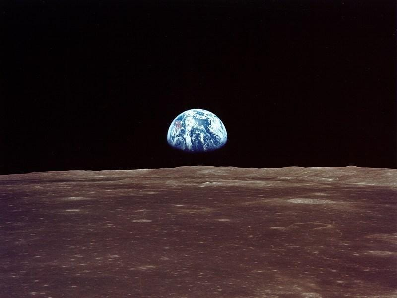Just hours before landing on the moon, one of the astronauts snapped Earth's rise as viewed from the lunar orbit.  (NASA)