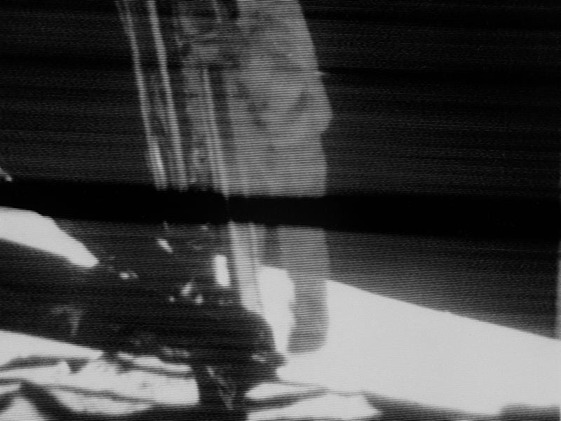 "Apollo 11 commander Armstrong about to set foot on the moon. It was at this moment, standing on the ladder, he proclaimed ""That's one small step for a man, one giant leap for mankind."" The image is blurry as it is a screen grab from a camera that live-streamed the landing.  (NASA)"