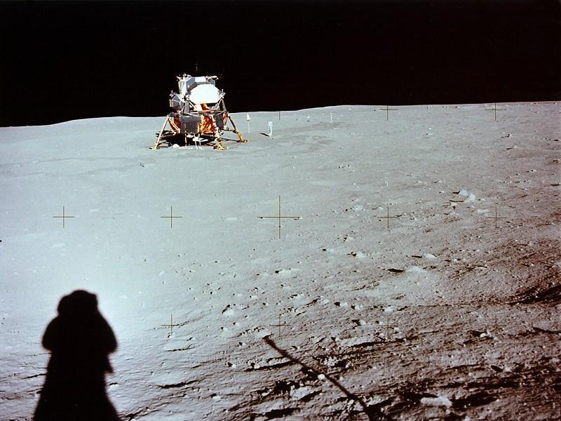 Armstrong taking a photograph of the lunar module parked on the moon's surface. His shadow can be seen at the left.  (NASA)