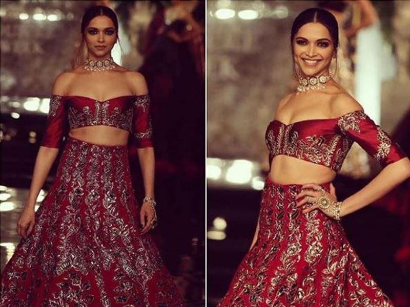 Deepika pulled out all the stops in her crimson off-shoulder lehenga. Deeper shades of plum and maroons, heavy detailing and embellishments, cut-out backs and elaborate trains on lehengas made up Malhotra's showcase. (Instagram)