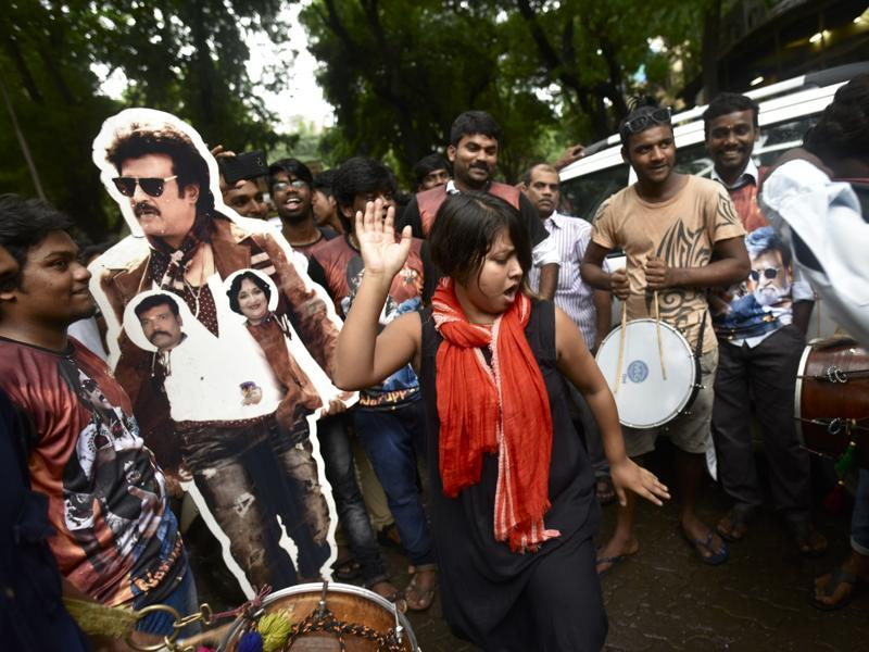 Rajinikanth fans dancing as they proceed with a procession on the release of his film Kabali at Matunga. (Photo by Arijit Sen/ Hindustan Times)
