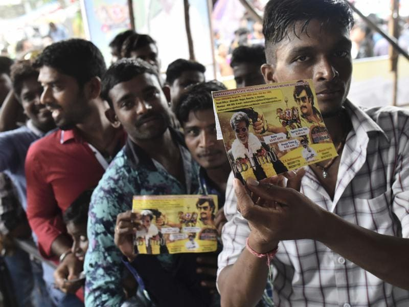 Rajinikanth fans flaunt their Kabali first day ticket as they enter to watch the movie on its release at Aurora talkies in Mumbai. (Photo by Arijit Sen/ Hindustan Times)