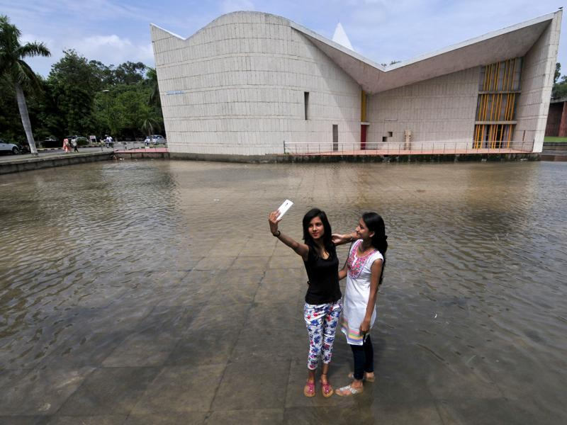 Girls taking a selfie at Gandhi Bhawan in Punjab University, Chandigarh after the morning shower on Saturday. (Ravi Kumar/HT Photo)