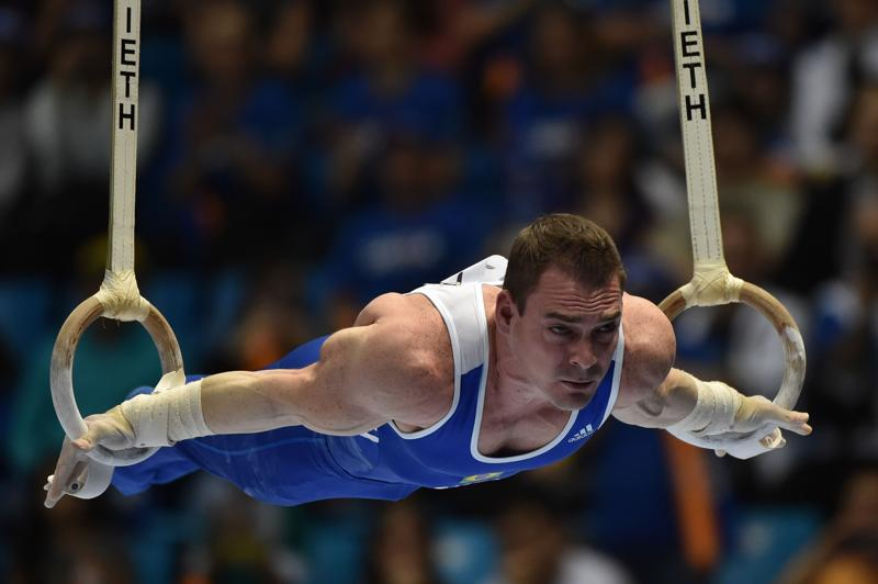 Having won Brazil's first olympic artistic gymnastics gold with a sparkling performance on the rings at London 2012, Arthur Zanetti is determined to do it all over again in front of his own fans in Rio. (AFP Photo)
