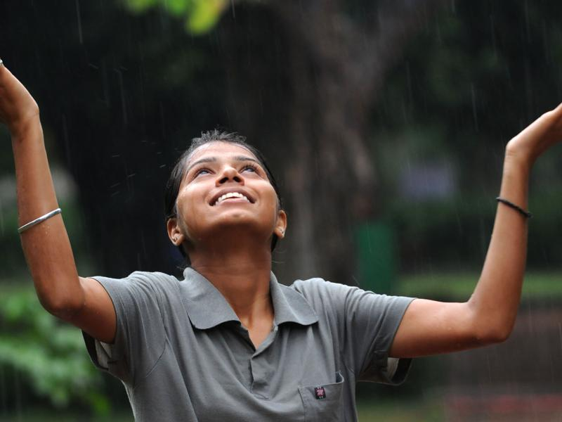A Girl enjoying the sudden rainfall in Patiala on Saturday. (Bharat Bhushan/HT Photo)