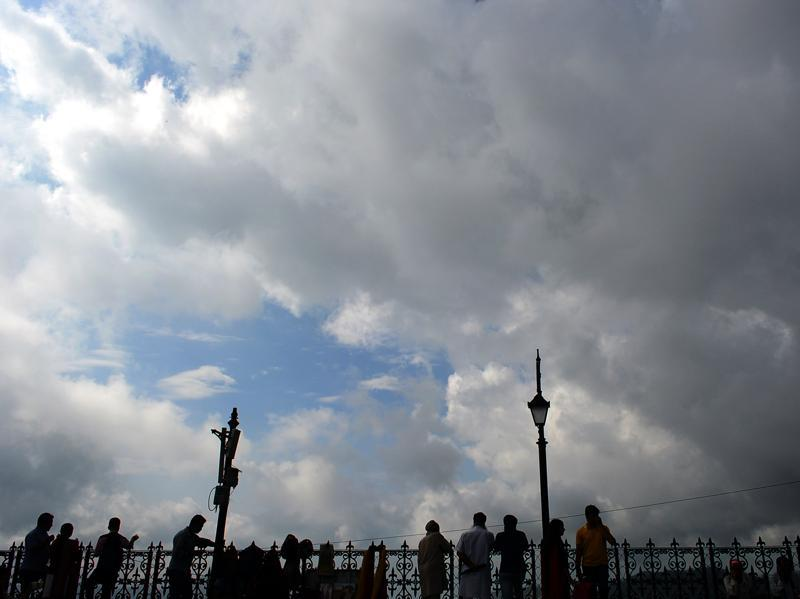 People enjoying a cloudy Saturday in Shimla on Saturday.  (Deepak Sansta/HT Photo)