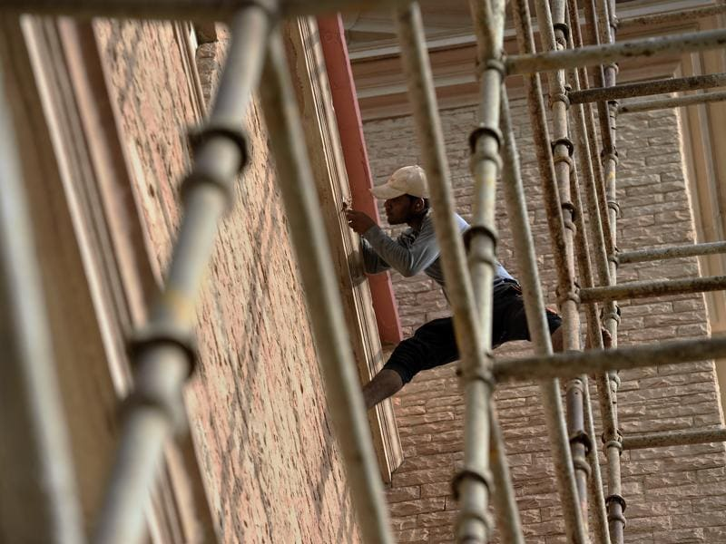 A worker fixes wall of the church. (Gurinder Osan/HT Photo)
