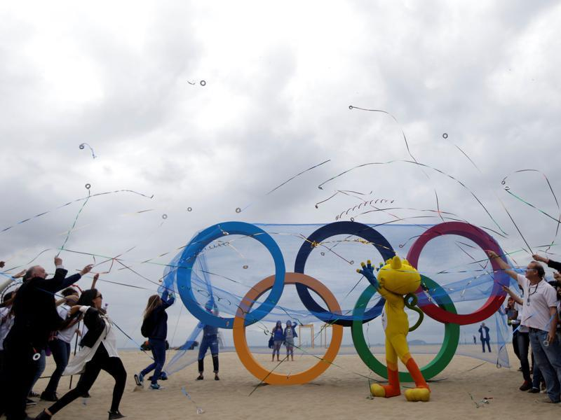 The 2016 Rio Olympics mascot Vinicius (C) attends the inauguration ceremony of the Olympic Rings placed at Copacabana Beach in Rio de Janeiro. (Reuters photo)