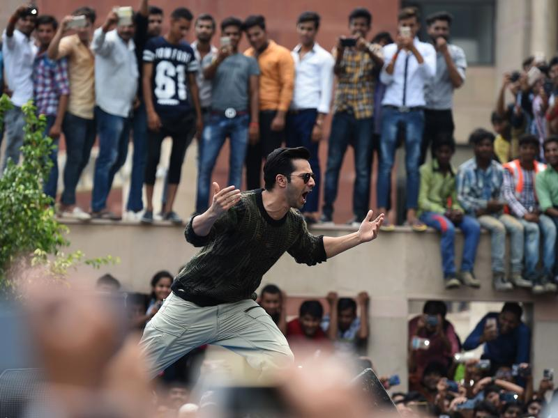 Varun Dhawan is all charged up as he gears up for live stunts infront of students in Noida. The event was a promotional one for his upcoming film Dishoom. (AFP)