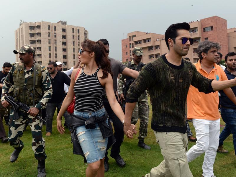 Varun Dhawan and Jacqueline Fernandez arrive for a promotional event of Dishoom in Greater Noida, 40km east of New Delhi. (AFP)