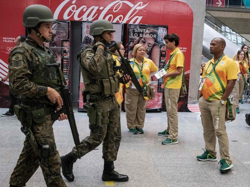 Brazilian Air Force personnel stand guard at the arrival level of the Galeao International airport (Aeroporto Internacional Antonio Carlos Jobim) in Rio de Janeiro. (AFP Photo)