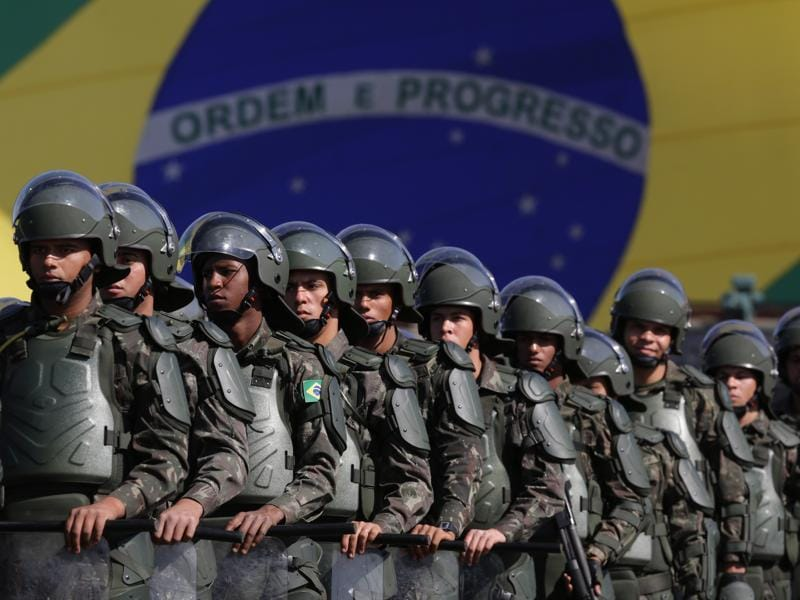 Brazilian Army soldiers take part in military exercise during presentation of the security forces for the Rio 2016 Olympic Games. (AP Photo)