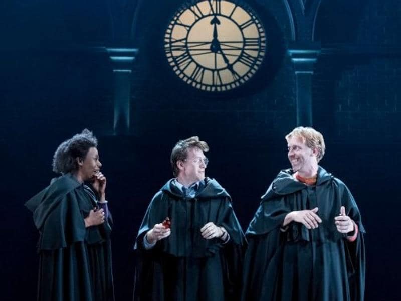Harry, Ron and Hermione share a light moment. In robes. Like the good old days. (Twitter)