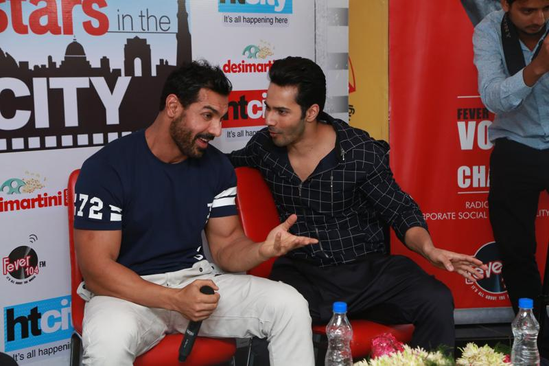 Varun and John enjoy each other's company. It's like They don't even miss Jacqueline! (Just kidding folks!) (PHOTO: AMAL KS/HINDUSTAN TIMES)