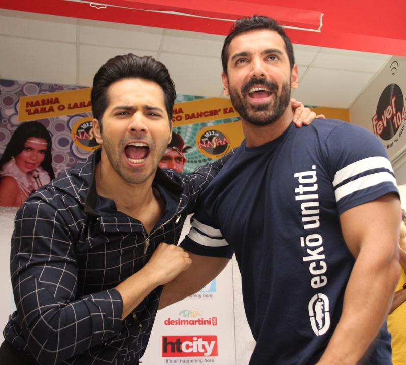 The super excited stars during a promotional visit to HT House on Tuesday. John and Varun were promoting Dishoom that releases on July 29. (PHOTO: SHIVAM SAXENA/HINDUSTAN TIMES)