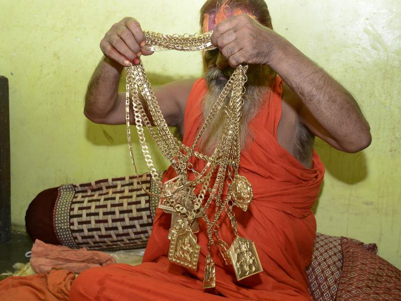 "When asked about where he gets all that gold, he says, ""Sab uper wala deta hai (The Almighty gives everything),"" he says, before explaining that it was bought with the money donated by his followers. (Sakib Ali /ht photo)"