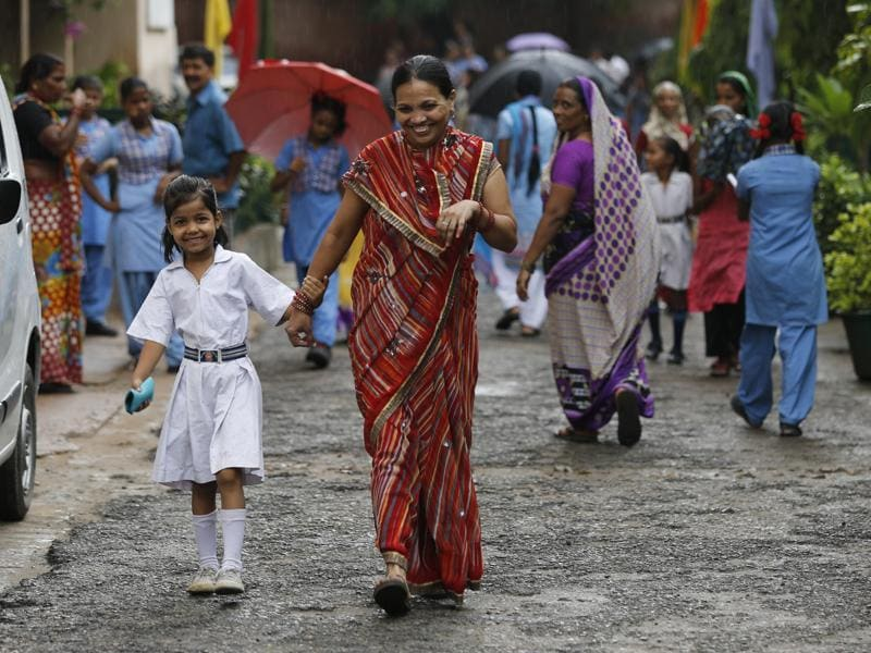 Some parents said they took leave from work to make sure they met the teachers of their children at government schools. A mother walks with her daughter to the Sarvoday Kanya Vidyalaya in West Patel Nagar for the parent-teacher meeting. (Sanchit Khanna/HT Photo)