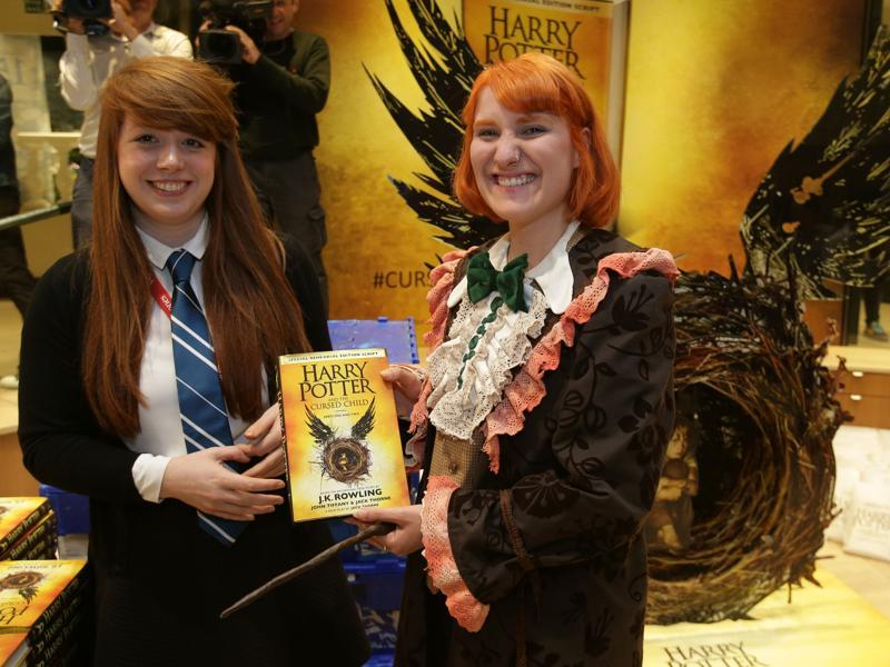 Harry Potter fan, Fran Plagge (right) with her copy of the book inside the Waterstones bookshop on Piccadilly in central London on Sunday.  (AFP)