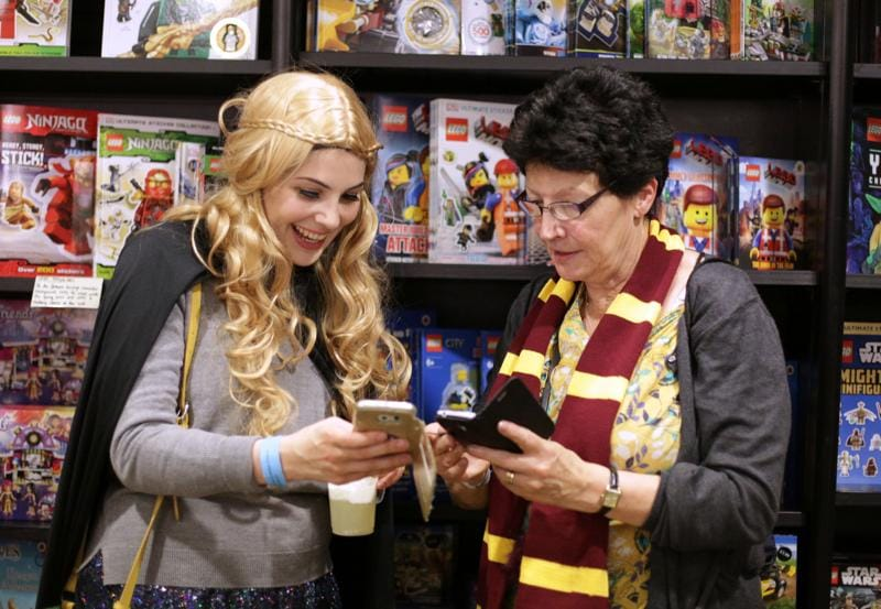 Harry Potter fans check their mobile phones inside Waterstones bookshop on Piccadilly in central London on Sunday.  (AFP)