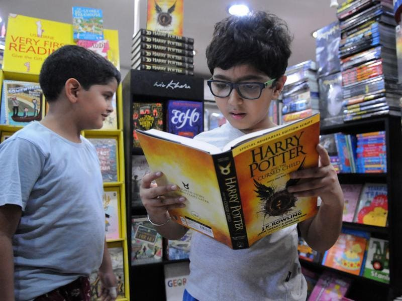 A boy reads the Harry Potter and the Cursed Child in Kool-S-Kool book store in Qutub Plaza Market in DLF Phase-1. (Parveen Kumar/HT Photo)