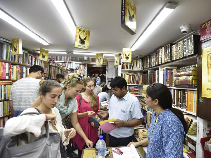 People buy copies of the 8th Harry Potter book at Bahrisons book shop at Khan market in New Delhi. (Virendra Singh Gosain/HT PHOTO)