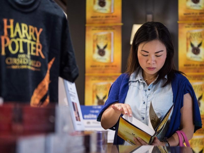 A customer with a copy of the latest Harry Potter book in Hong Kong on Sunday.  (AFP)