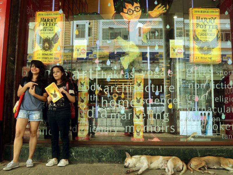 Fans pose with their newly bought copy of Harry Potter and The Cursed Child.  (Prateek Choudhury/HT Photo)