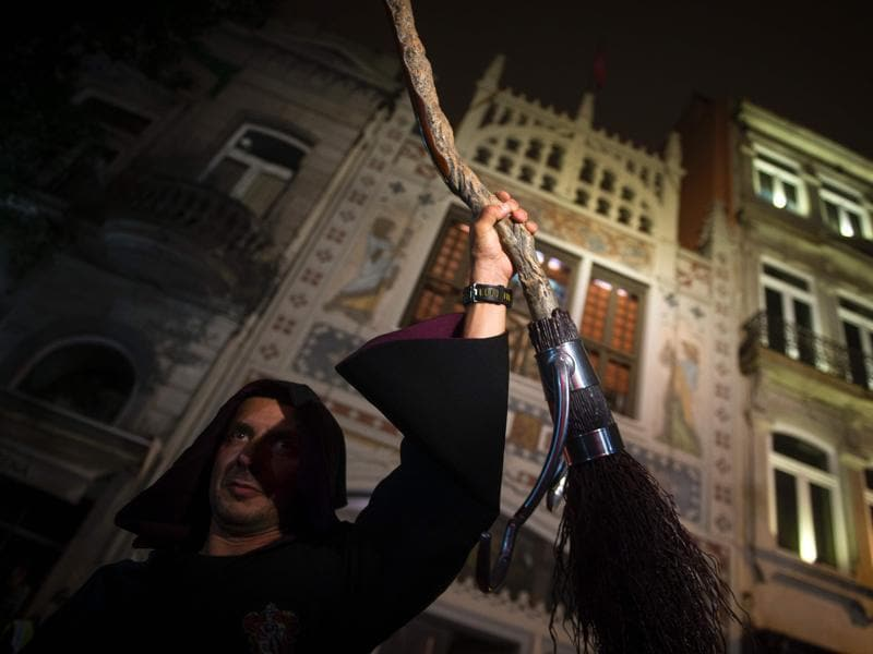 An actor performs before the launch of the book at Lello, a Gothic Revival style bookstore in the historic centre of Porto, Northern Portugal. (AFP)