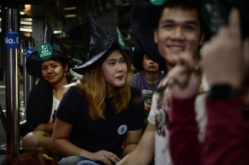 Fans wait to receive the copy of their Harry Potter book outside a bookstore in Bangkok on Sunday.  (AFP)