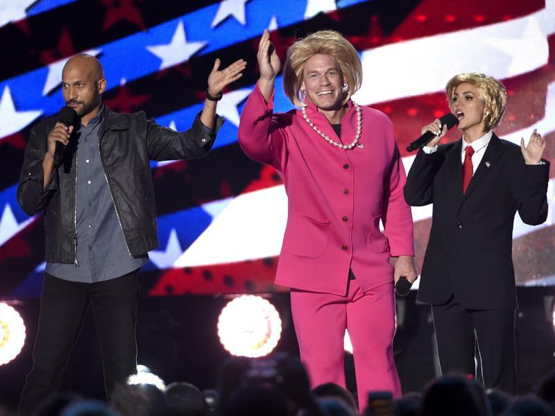 Keegan-Michael Key, from left, John Cena, dressed as Hillary Clinton and Victoria Justice, dressed as Donald Trump, perform a skit at the Teen Choice Awards at the Forum. (Chris Pizzello/Invision/AP)