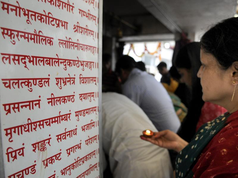 Devotees offer prayers at a temple in Noida. (Sunil Ghosh/HT Photo)