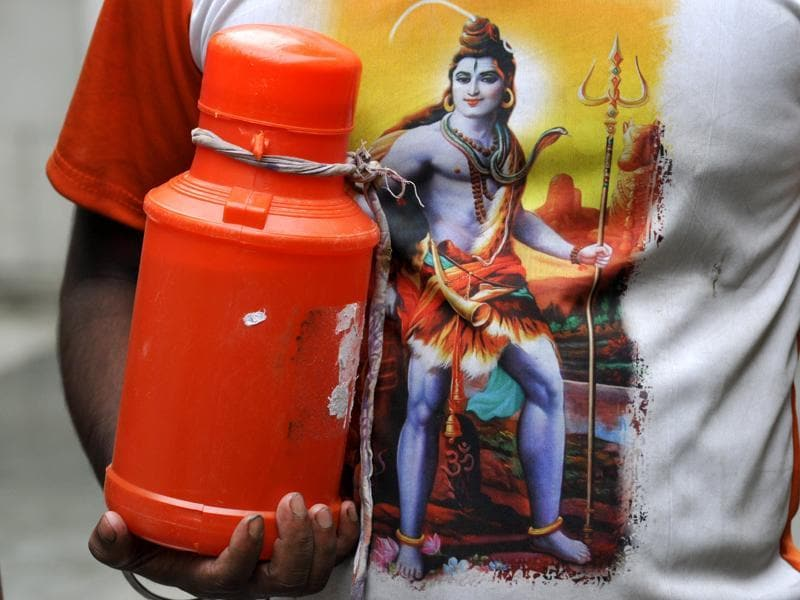 A Kanwariya can be seen with holy water collected from Ganges in Haridwar.  (Sunil Ghosh/HT Photo)
