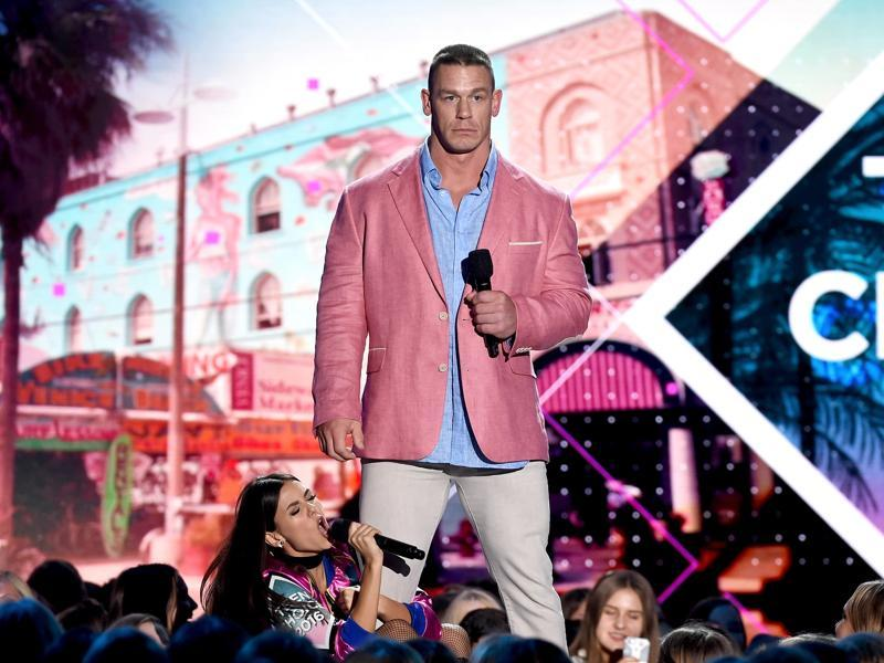 Co-hosts Victoria Justice and John Cena speak onstage during Teen Choice Awards 2016. (AFP)