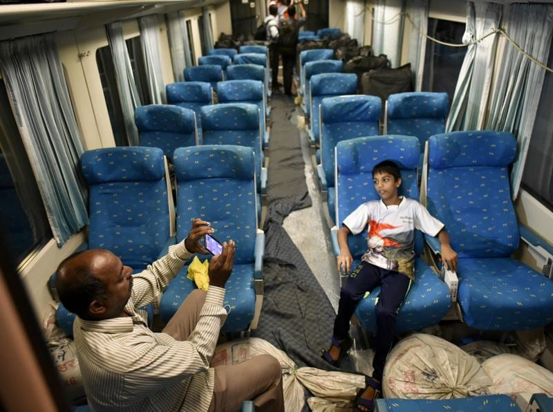 People takes photos inside a coach of Spanish Talgo train which arrived in Mumbai Central from Delhi in Mumbai.  (ARIJIT SEN/Hindustan Times)