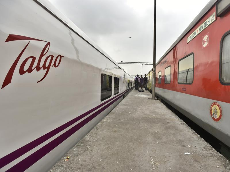 A high-speed Talgo Talgo train stands on a platform next to a Rajdhani Express before its final trial run between Delhi-Mumbai.  Indian Railways is conducting trial runs with Talgo train coaches, which the Spanish company claims can help Railways attain higher speeds, even on the existing tracks. (Raj K Raj/HT PHOTO)