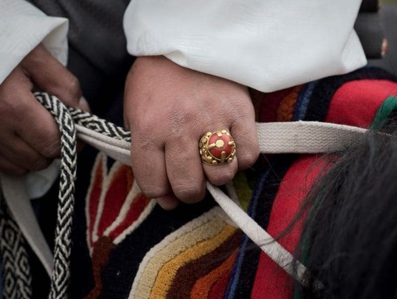 A man sports a traditional ring -- a semi-precious stone embedded in metal, possibly gold. (AFP)