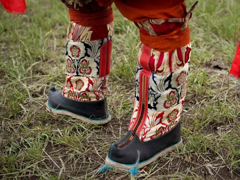 A look at traditional boots in silk with floral designs.  (AFP)